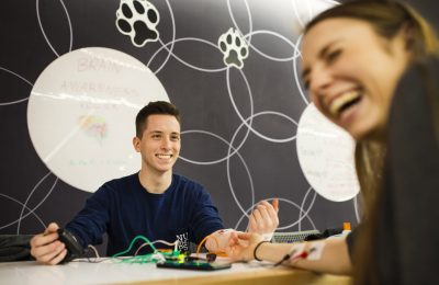 Two students use the human to human interface kit to control their arm movements.