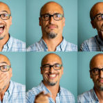 Man poses for 6 headshots with varying facial expressions